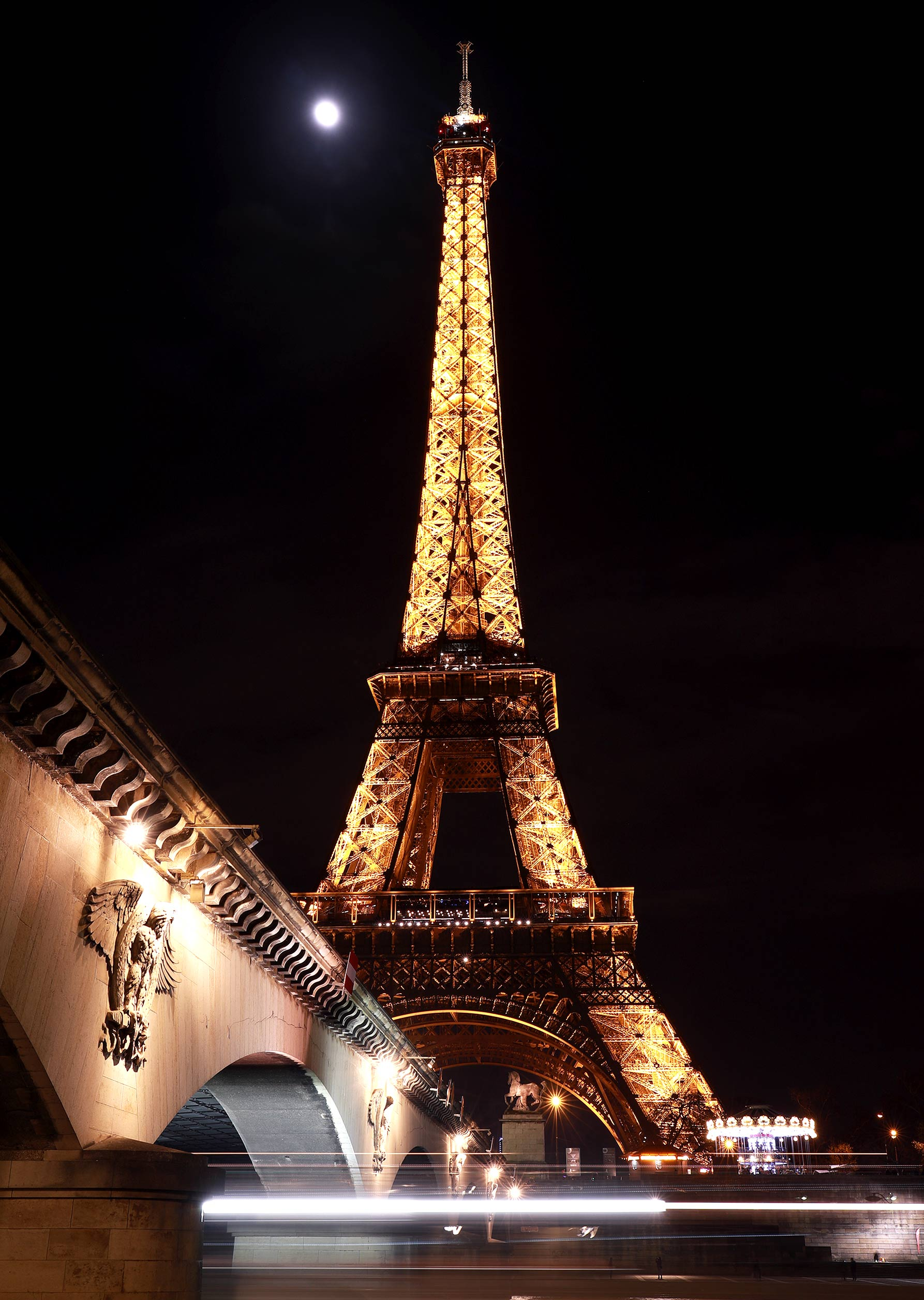 Long exposure night time photograph of the Eiffel Tower in Paris