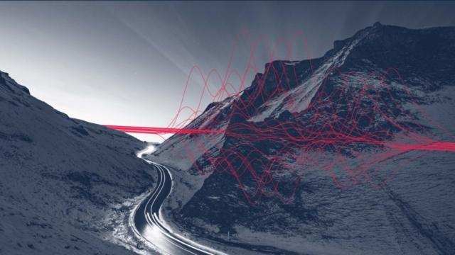 DLA Piper string sculpture weaving between mountains