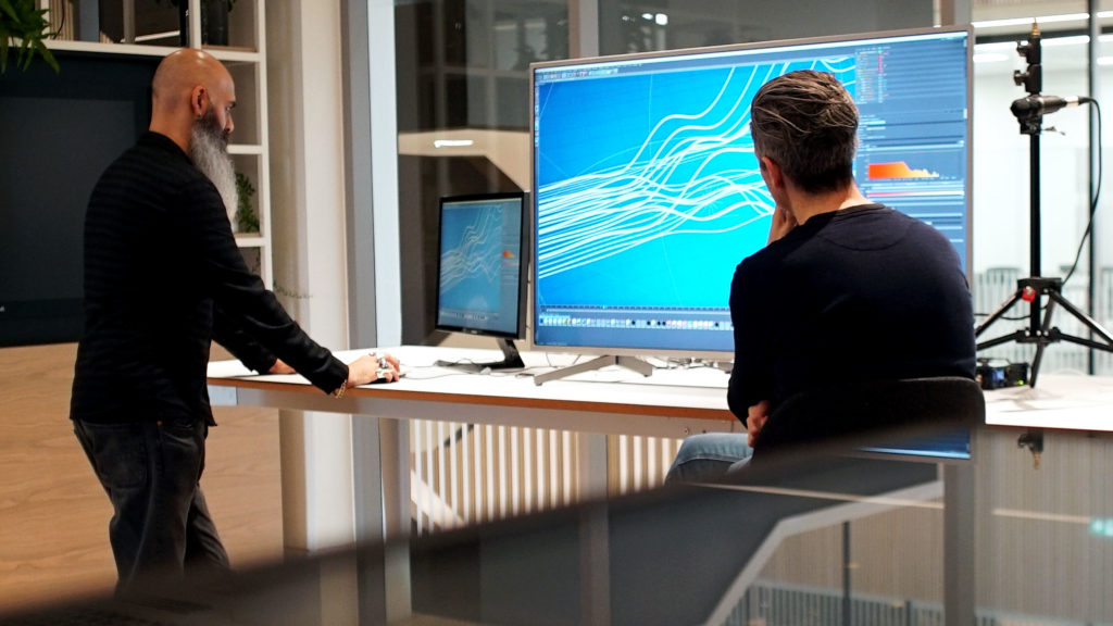 Mitul Rajani and Will Hambling demonstrating 3D modelling software on large screens