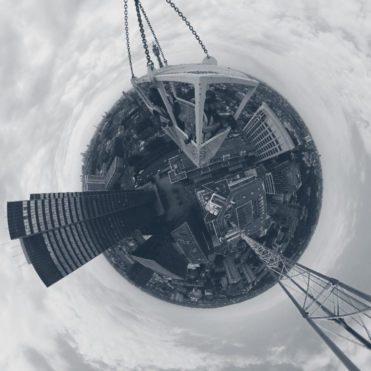 A 360 degree camera view of a construction site seen from on top of a crane, looking over central London.