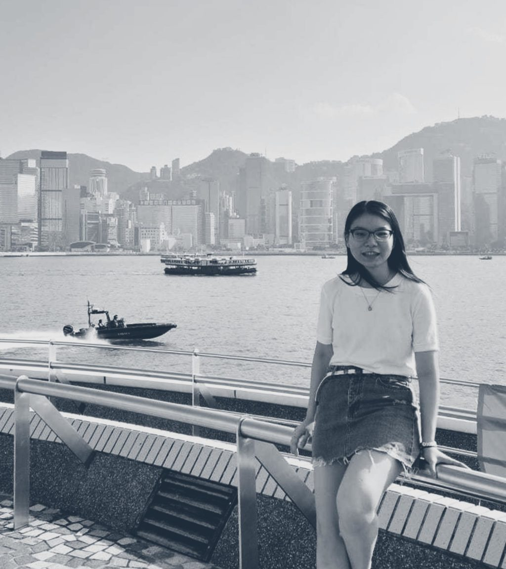 Elizabeth Ng standing in front of Hong Kong harbour.