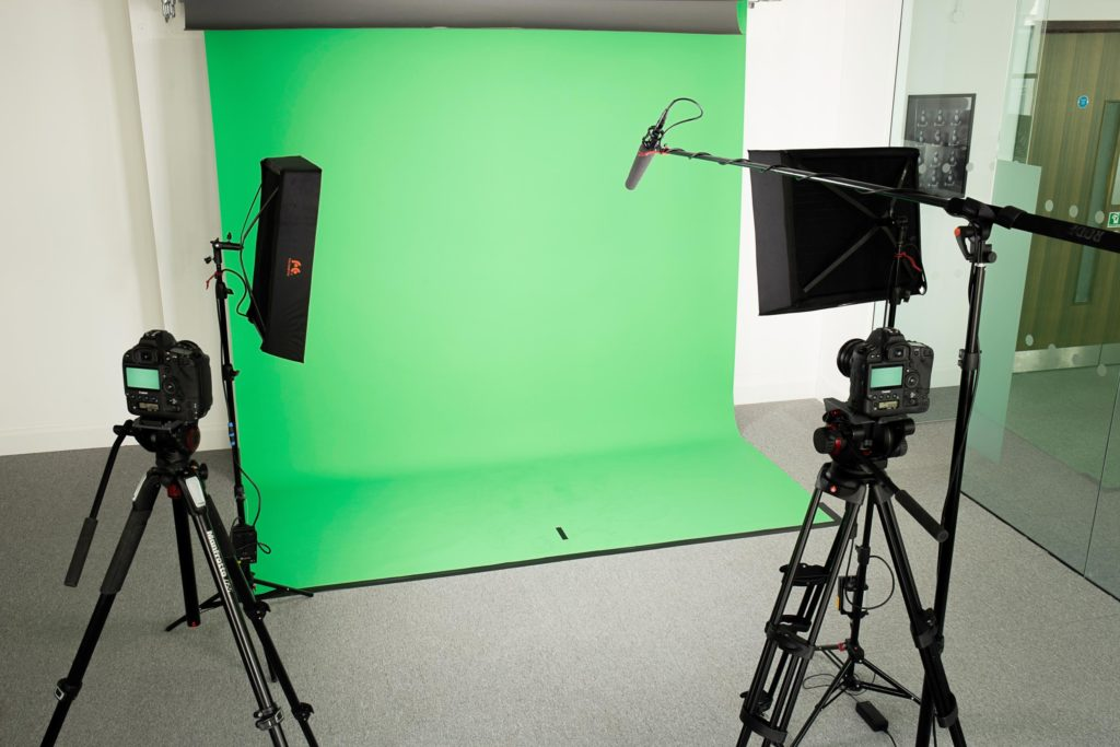 Photograph of a green screen filming studio.